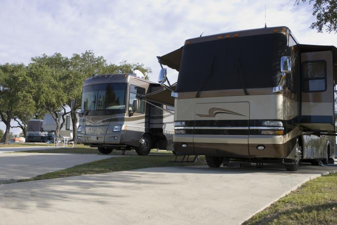 Two luxury motorhomes at RV park