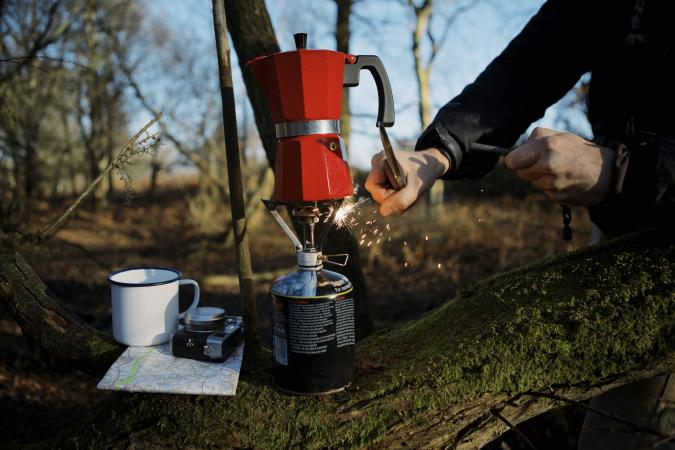 Igniting a camp stove
