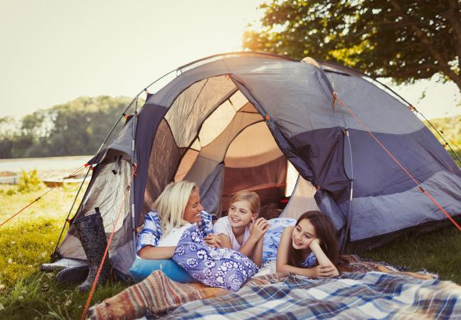 woman and kids camping with tent