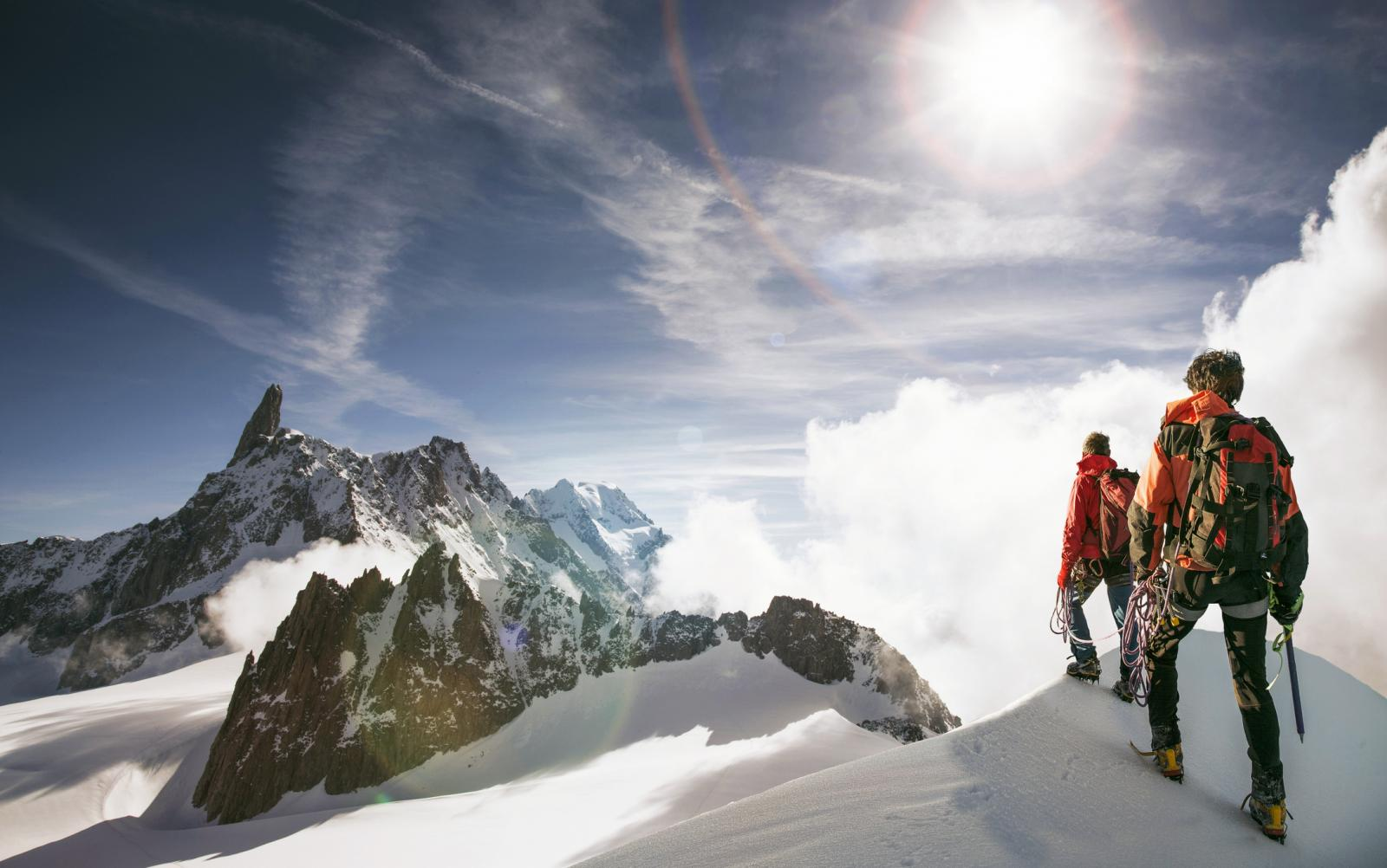 Hikers standing on snowy mountain top