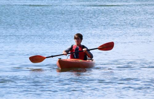 Kayak rider paddling his boat