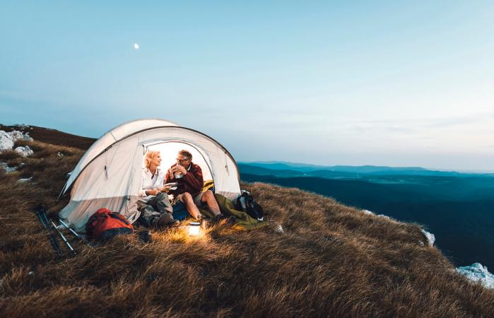 Couple camping in the mountains