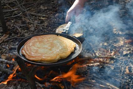 pancake cooking on campfire
