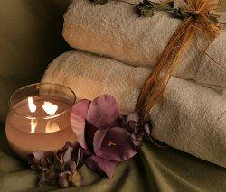 a homemade candle next to some towels