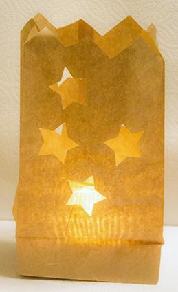 pierced paper bag candle holder