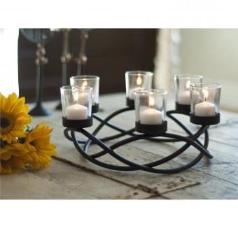 https://cf.ltkcdn.net/candles/images/slide/200586-850x850-Danya-B-Round-Waves-Candle-Holder.jpg