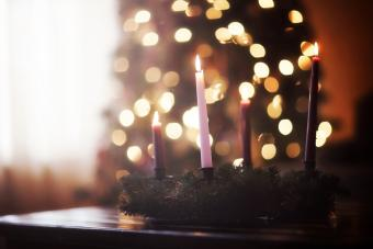 Advent wreath in front of Christmas tree