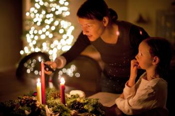 Mother and daughter lighting candles at Advent