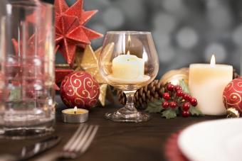 Dining table place setting with Christmas holiday decorations
