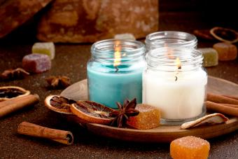 Candles in a wooden plate with orange and cinnamon