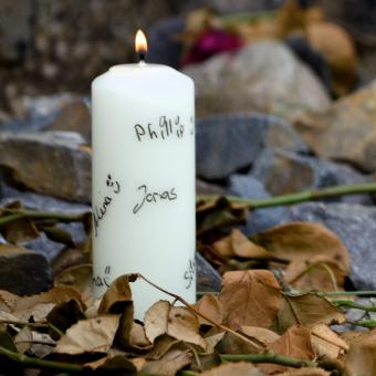 White candle with names on it