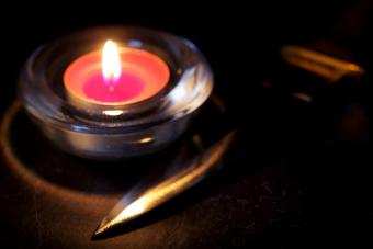 Red candle and an athame