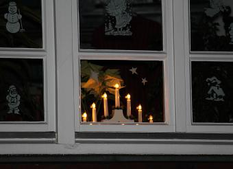 Electric christmas candles in window