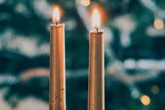 Illuminated Candles On Table