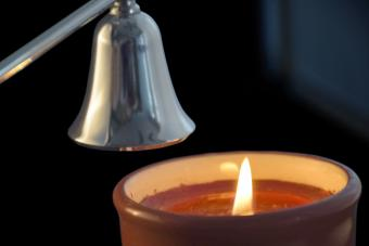 Candle about to be extinguished by a candle snuffer