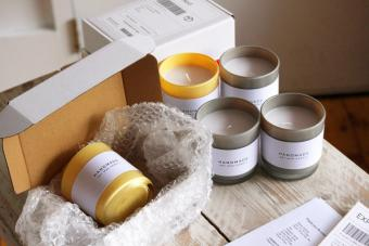 A small home candle making/crafting business set up with customer orders and parcels in shot