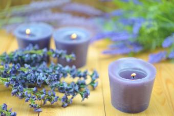 Scented Candles And Lavender On Table