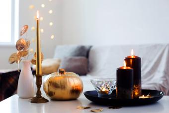 Gold Candle Meanings: Victory, Optimism, & Enlightenment