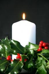 a pillar candle in an Advent wreath