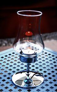 A teardrop candle holder accentuates the beauty of candlelight.