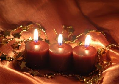 three red candles in a handmade holder