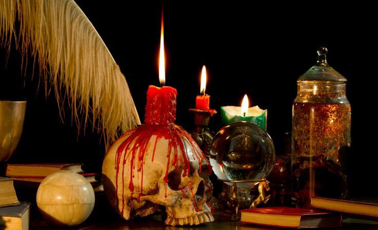 skull candle holder on desk