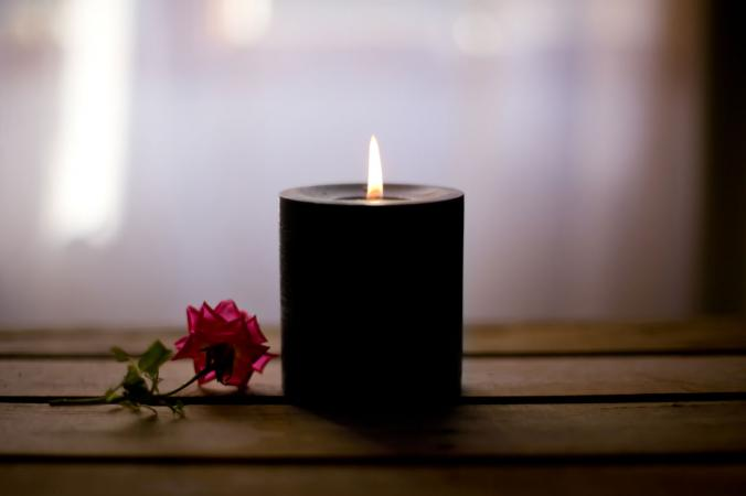 black candle with red rose