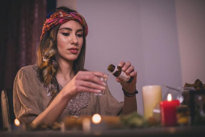 Woman making scented beeswax candles