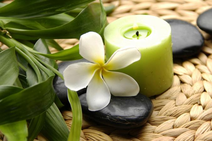 Green candle with Frangipani flower