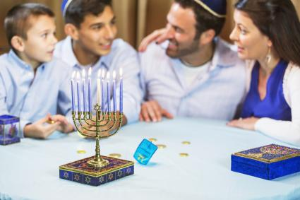 Family of four celebrating hanukkah