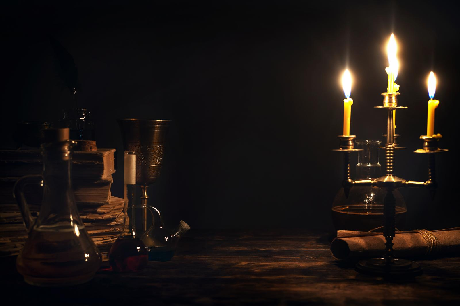 Alchemist table with yellow candles