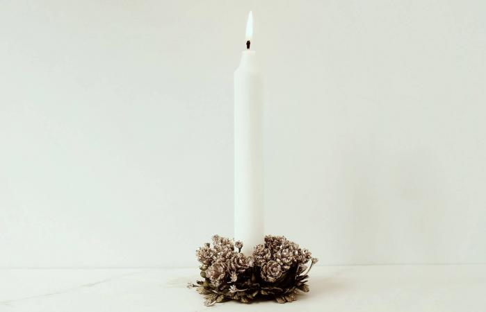Illuminated Candle On Table