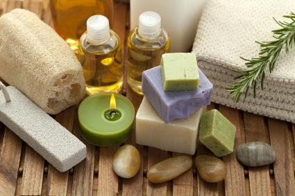 Spa concept with candle, rosemary, towels, soap, massage oil