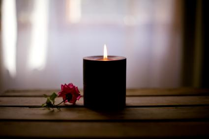 Black candle with rose