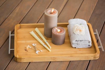 Tray with ear candles, cotton swabs, and towel