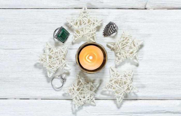 Burning candle with rings