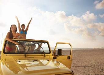 girls riding on a jeep