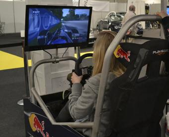 Woman using driving simulator