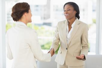 businesswomen meeting and shaking hands