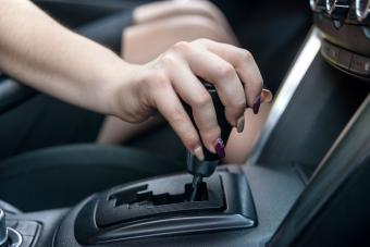 Female hand on automatic transmission car lever
