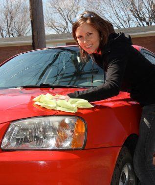 woman washing car