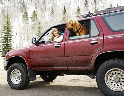 Woman and dog in SUV