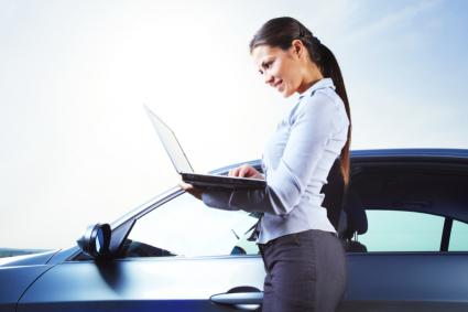 woman with car and computer