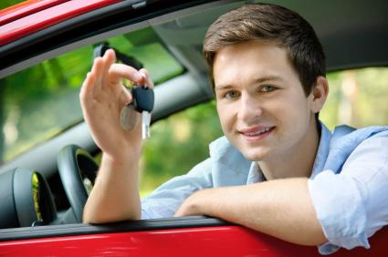 Young man with car key