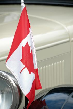 Antique car with Canadian flag