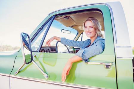 woman sitting in truck