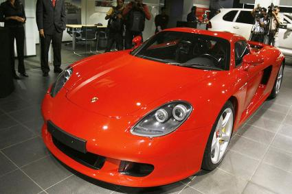 A red Porsche carerra GT in a stand