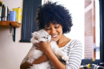Young woman enjoying a cuddle with her cat