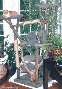 Complex rustic cat tree with feline occupant