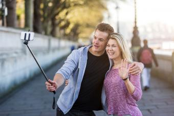 Couple taking a selfie with selfie stick